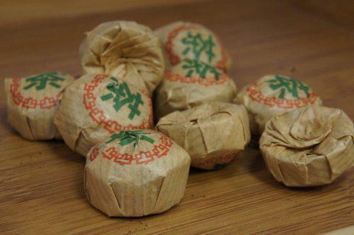 Купить настоящий китайский прессованный чай шу в таблетках мини то ча пуэр Путь Чая Оптом и в розницу с доставкой. Фото.